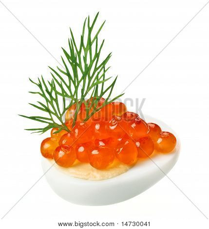 Red Caviar Canape With Quail Egg And Dill Twig
