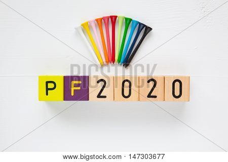 P.F.2020 - an inscription from children's wooden blocks and golf tees - Flat Lay Photography