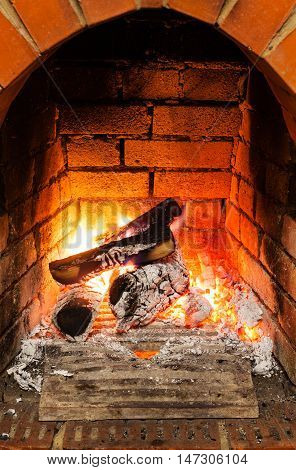 Ash, Coal And Burning Wooden Logs In Fireplace