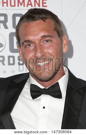 LOS ANGELES - SEP 10:  Brandon McMillan at the 2016 American Humane Hero Dog Awards at the Beverly Hilton Hotel on September 10, 2016 in Beverly Hills, CA