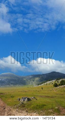 Dinara Mountain Over Blue Sky 4