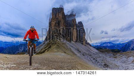 Mountain biking in the Dolomites. Amazing view of Tre Cime di Lavaredo in background.