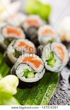 Yin Yang Maki Sushi - Roll made of Fresh Salmon and Cucumber inside. Nori Outside