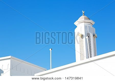 In Oman Muscat The Old Mosque Minaret And Religion In Clear Sky