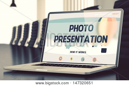 Modern Meeting Hall with Laptop on Foreground Showing Landing Page with Text Photo Presentation. Closeup View. Toned Image with Selective Focus. 3D.