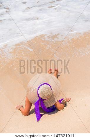 Woman in bikini at the  tropical beach