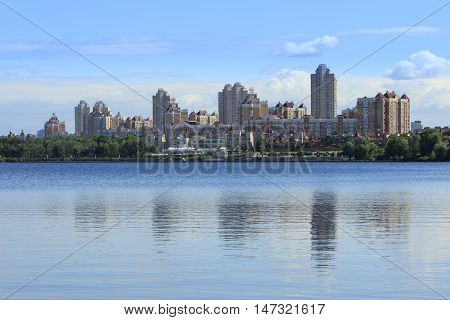 City quay landscape with a river and reflections. Kiev Ukraine.
