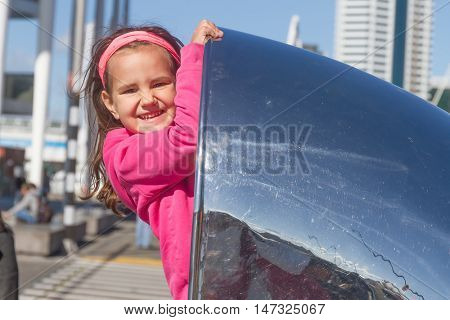 young happy kid girl having fun outdoors, auckland, new zealand