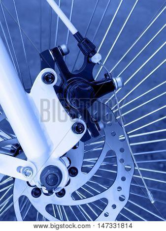 Rear disc brake on cruiser bike. Toned in blue color