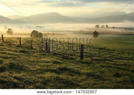 morning light landscape with dust and clouds