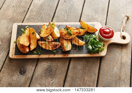 baked roasted potato wedges with herbs and red sauce