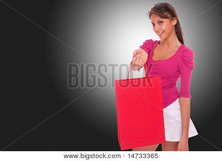 Beautiful woman  shopping  over dark gray background