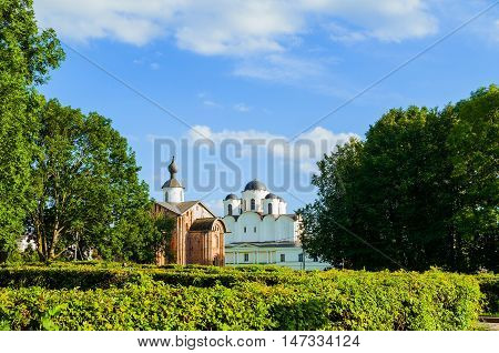 Paraskeva Pyatnitsa church and St Nicholas cathedral at Yaroslav Courtyard in Veliky Novgorod Russia - architecture panoramic view in sunny summer weather