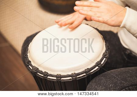 Drummer Plays On Small African Drum