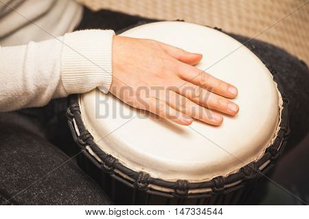 Drummer Plays On African Drum