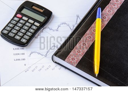 Finance. Calculator on the desk pen, calculations
