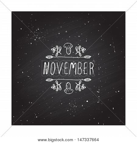 Hand-sketched typographic element with mushroom, berries and text on chalkboard background. November