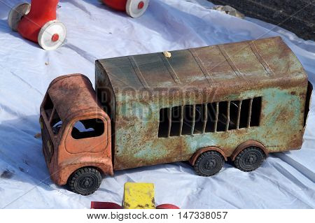 Old rusty toy for in the form of the truck