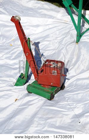 Old children's toy in the form of the mobile excavator
