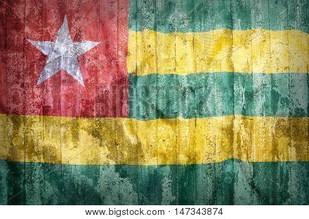 Grunge Style Of Togo Flag On A Brick Wall