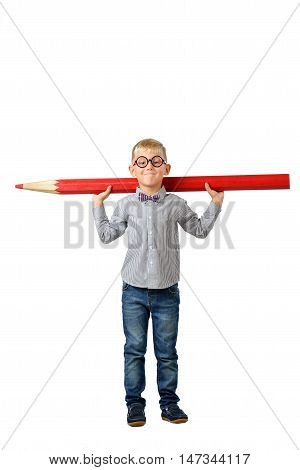 Happy boy in glasses and bowtie posing with a huge pencil. Educational concept. Isolated over white. School preschool