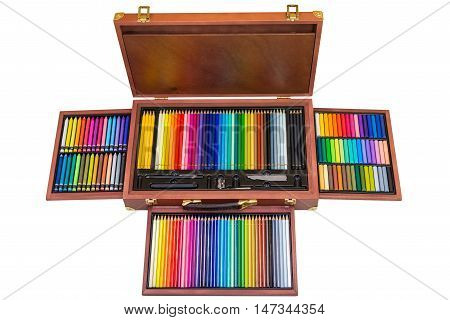 set of colored pencils in a wooden box isolated on white background