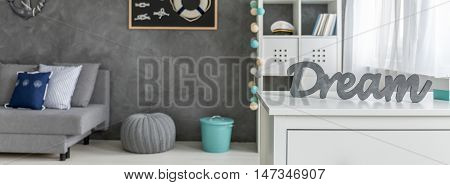 Decorative dream word on commode in marine style room