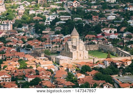 Mtskheta, Georgia. Top View Of The Svetitskhoveli Cathedral Of The Living Pillar, Georgian Orthodox Church, Unesco Heritage. The Sityscape Of Historic Old Town With Tile Roofs.