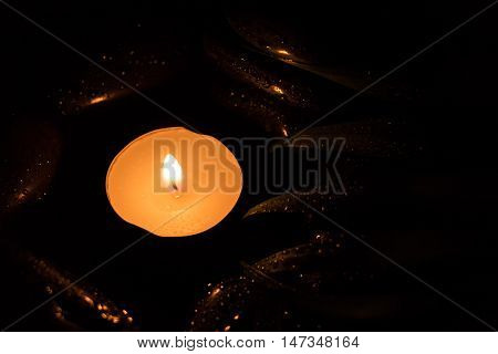 Scent Lighted Candle On Black Wet Stones, Dark Photography