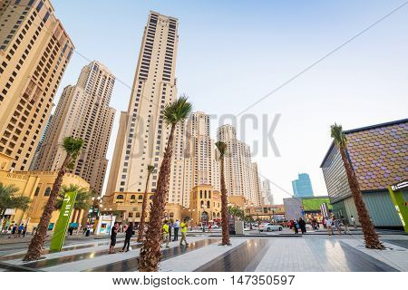 DUBAI, UAE - MARCH 30: City scenery of Dubai Marina at night on March 30, 2014, UAE. Dubai Marina is a district in Dubai with artificial canal skyscrapers who accommodates more than 120,000 people.