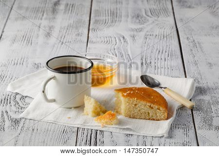 piece of cake on table with old iron mug