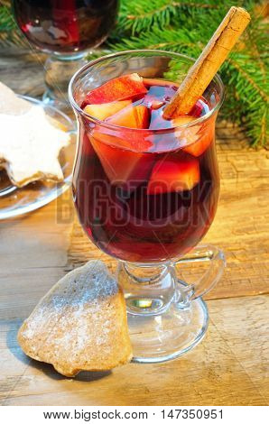 Mulled Wine With Cinnamon Sticks In Glass And Christmas Cookies