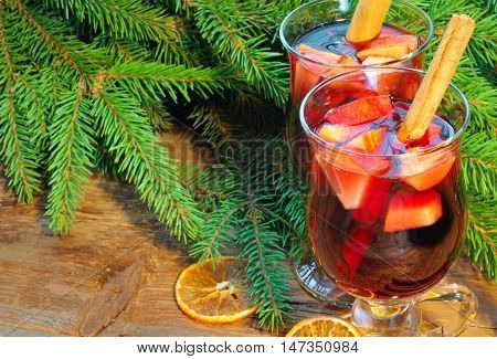 Two Glasses Of Mulled Wine And Christmas Tree Branches