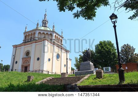 Crespi d'Adda, Italy - June 23, 2016: Church at historic industrial town Crespi d'Adda near Bergamo, Lombardy. The town is an example of the