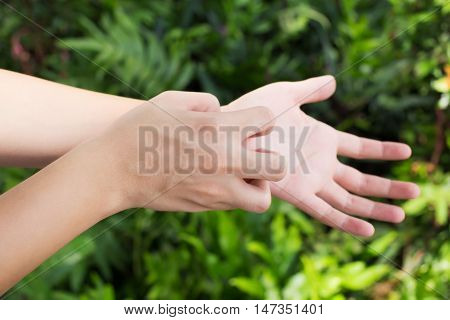 Man scratch the itch with hand Arm Itching Concept with Healthcare And Medicine.