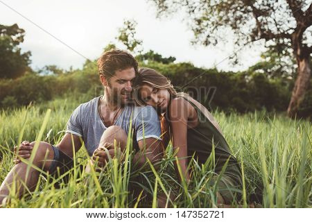 Romantic Young Couple Relaxing In Meadow