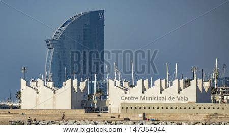 BARCELONA SPAIN - JULY 2 2016: The Municipal Sailing Centre is located in Barcelona Port Olimpic next to the beach. Nautical offers various courses - sailing catamaran windsurfing etc.