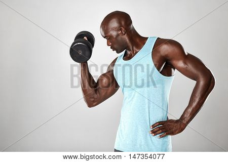 Young Muscular Man Doing Heavy Dumbbell Exercise
