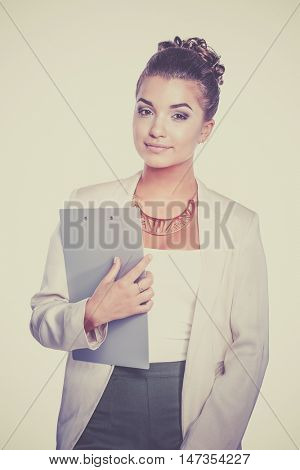 Portrait of business woman standing with folder