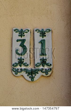 Detail Of Street Number Ceramic With Old Green Decorations, .