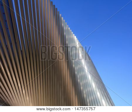Abstract metallic surface shining on sky background