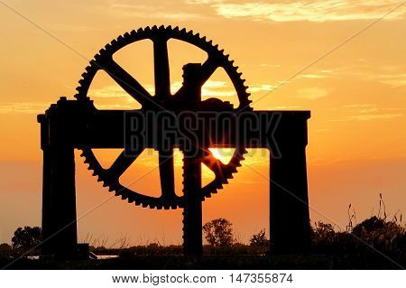 Sluice wheel at Startops End reservoir at sunset
