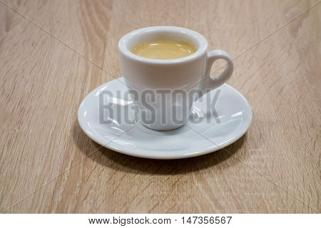 Cup of the coffee on the wooden table