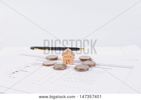House and coins stack realestate concept, isolated