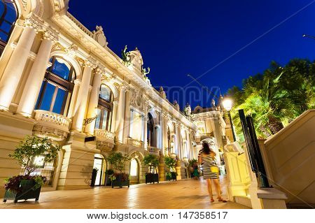 The grand Casino Monte - Carlo at night with illuminated facade. The Kingdom of Monaco on Azure coast.
