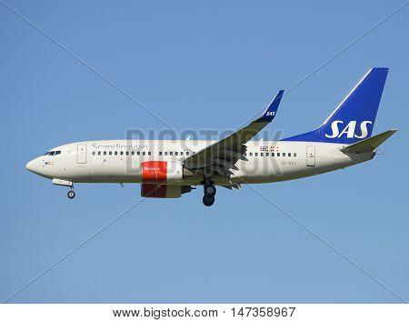 SAINT PETERSBURG, RUSSIA - AUGUST 21, 2015: The Boeing 737-700 (SE-REY) SAS before planting