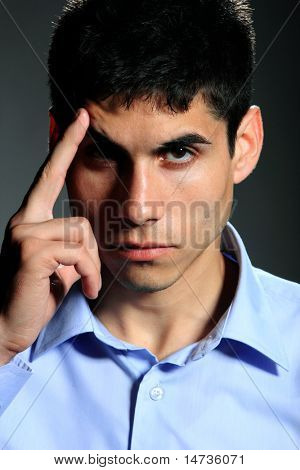 Full lengh of a handsome businessman thinking. on dark background