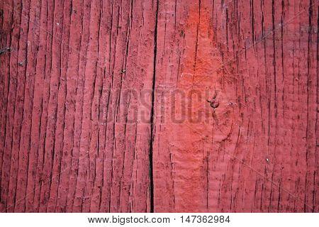 Red varnished aged grunge messy wooden background