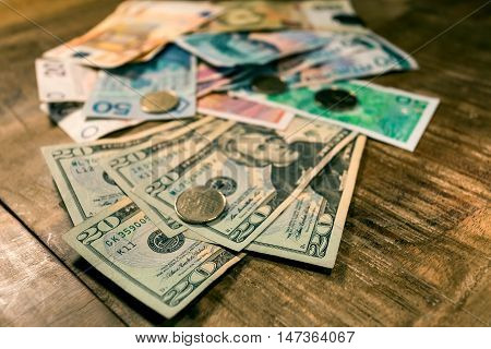 Variable banknotes on wooden top table currency exchange currency war