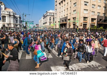 MEXICO CITY, MEXICO-DEC 6, 2015: People walking on zebra crossing and traffic jam on Dec 6, 2015  in Zocalo, Center of Mexico City, Mexico.